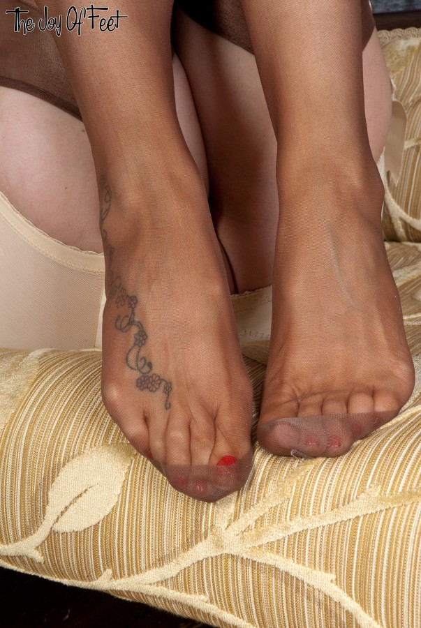 Adoration of nylon feet by slaves with a lot of sperm 4